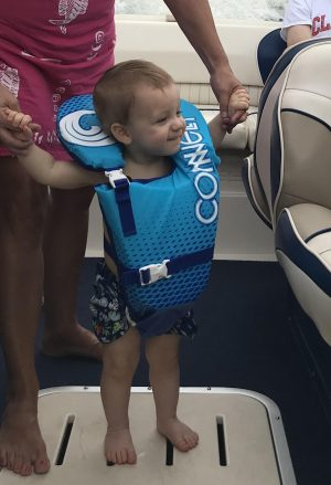 boating with baby standing on boat